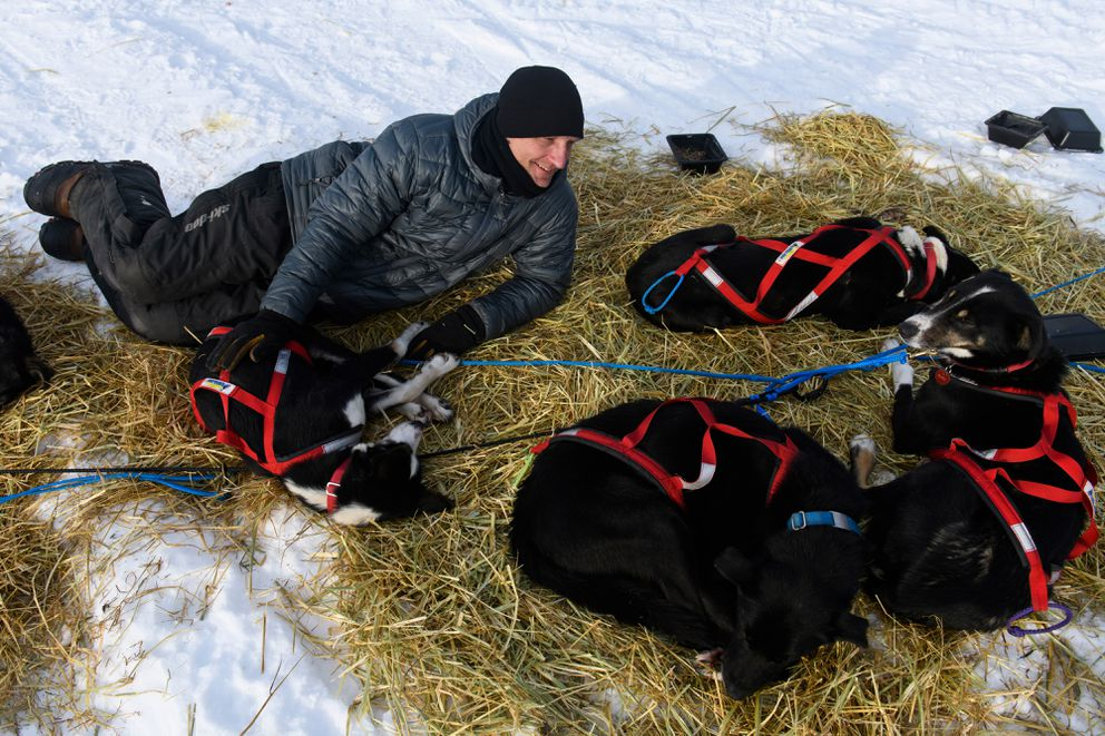 Charley Bejna rests with on the straw with his dogs at Finger Lake. (Marc Lester / ADN)