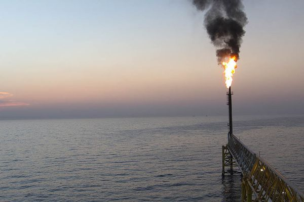 Gas flares from a burner tower on the Petroleos Mexicanos (Pemex) Pol-A Platform complex, located on the continental shelf in the Gulf of Mexico on March 28, 2014. MUST CREDIT: Bloomberg photo by Susana Gonzalez.