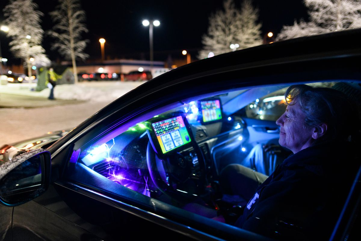 Dawn Dunbar plays bingo in her festively decorated vehicle during a session of curbside bingo at Tudor Bingo Center on Friday evening, December 11, 2020. (Marc Lester / ADN)