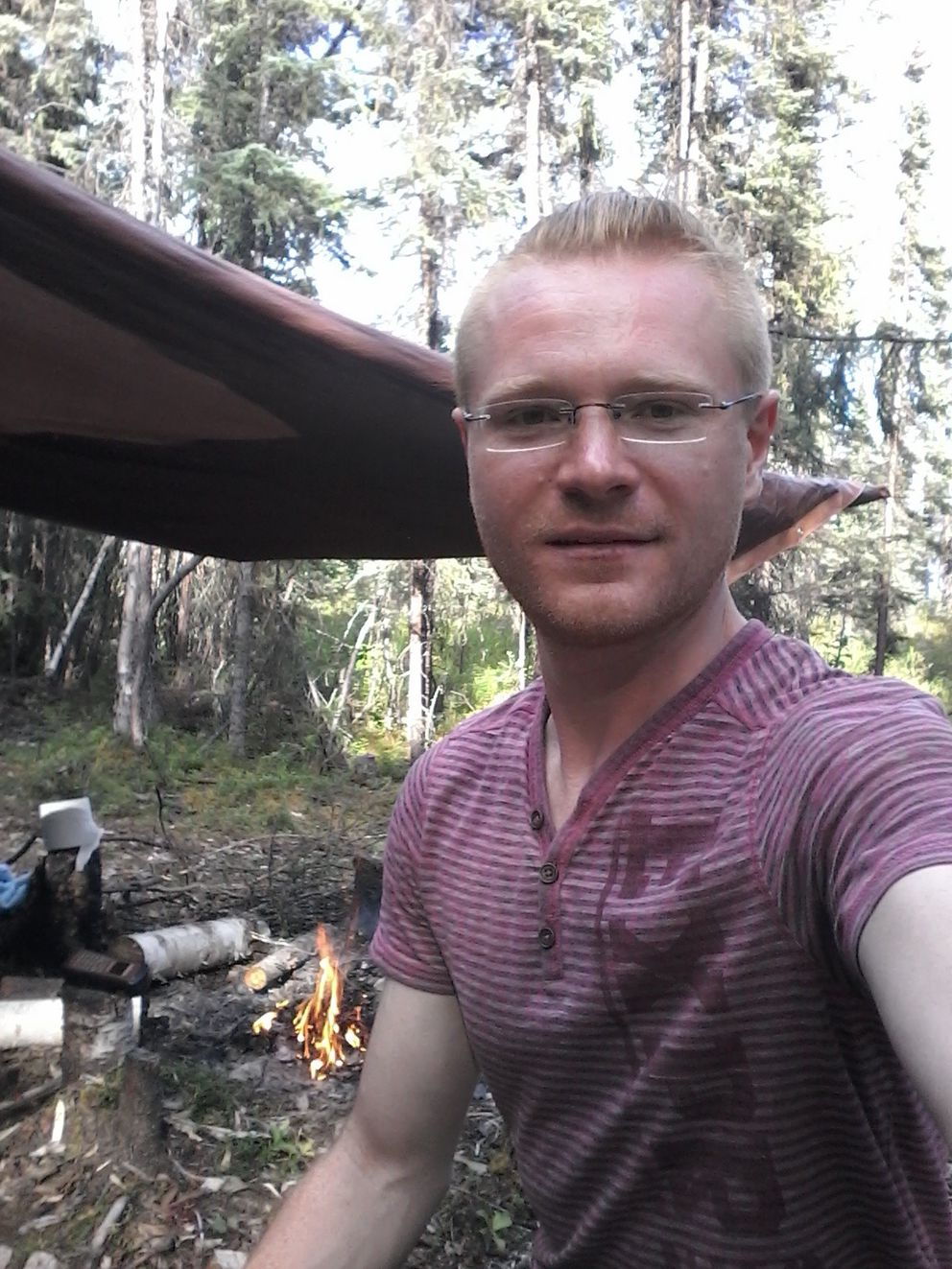 Vladimir Yakushin, 29, is pictured on June 24, 2016, at Chleca Lakes in Interior Alaska at the partially built cabin of another adventurer that he borrowed. He had hoped to build his own cabin this summer. Alaska State Troopers rescued him from the North Fork Kuskokwim River on Wednesday. (Photo courtesy of Vladimir Yakushin)