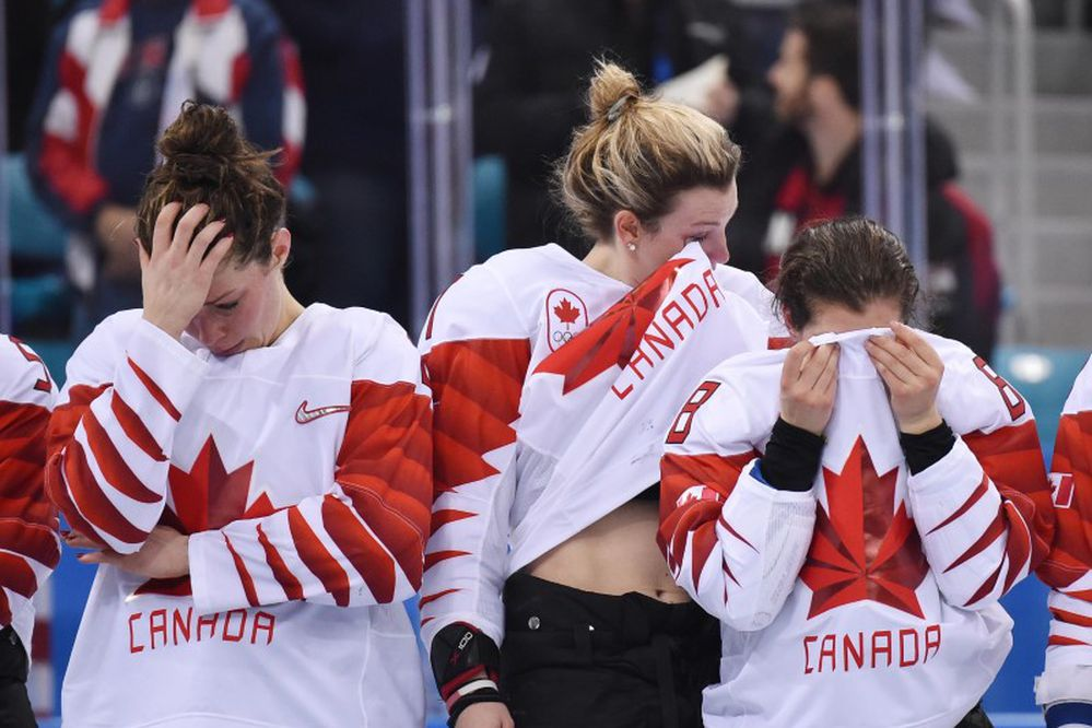 Feb 22, 2018; Gangneung, South Korea; Canada players from left Rebecca Johnston Laura Stacey and Laura Fortino react after losing to the United States in the women's ice hockey gold medal match during the Pyeongchang 2018 Olympic Winter Games at Gangneung Hockey Centre. (Andrew Nelles-USA TODAY Sports)