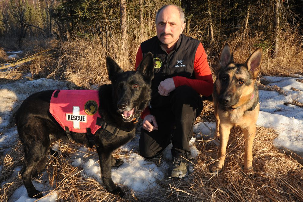 Paul Stoklos, with dogs Mora, left, and LZ,  has been a volunteer with Alaska Search and Rescue Dogs for over 25 years.  (Bill Roth / Alaska Dispatch News)