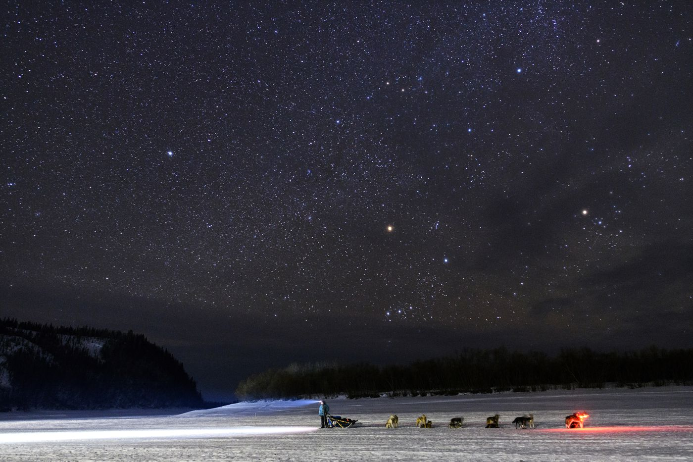 Kristy Berington waits on the Innoko River for her sister, Anna Berington, after they both left Shageluk during the Iditarod on March 9. (Marc Lester / ADN)