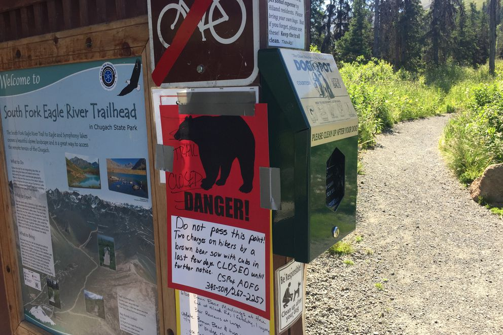 A sign warns hikers of a trail closure due to bear activity at the South Fork Eagle River trailhead on Thursday, July 19, 2018. (Matt Tunseth / Alaska Star)