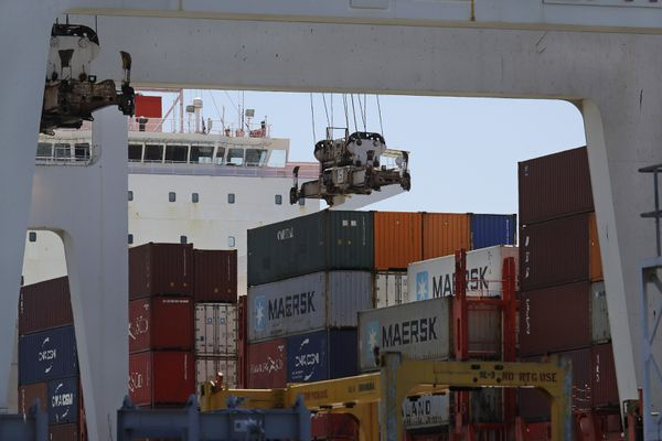 FILE - In this July 22, 2019, the container ship Kota Ekspres is unloaded at the Port of Oakland in Oakland, Calif. On Wednesday, Oct. 30, the Commerce Department issues the first estimate of how the U.S. economy performed in the July-September quarter. (AP Photo/Ben Margot, File)