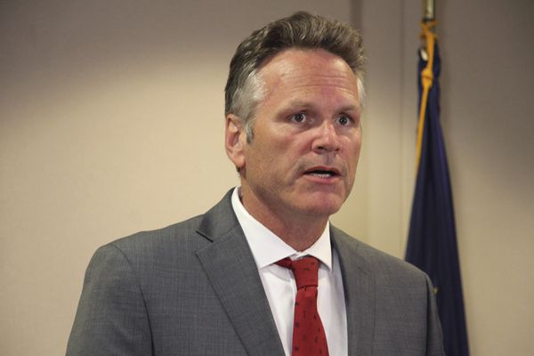Alaska Gov. Mike Dunleavy speaks at a news conference in Anchorage, Alaska, Tuesday, Aug. 13, 2019. Dunleavy said he would support a $25 million cut this year to the University of Alaska system. That is a sharp reversal from the $135 million cut Dunleavy earlier endorsed. (AP Photo/Mark Thiessen)