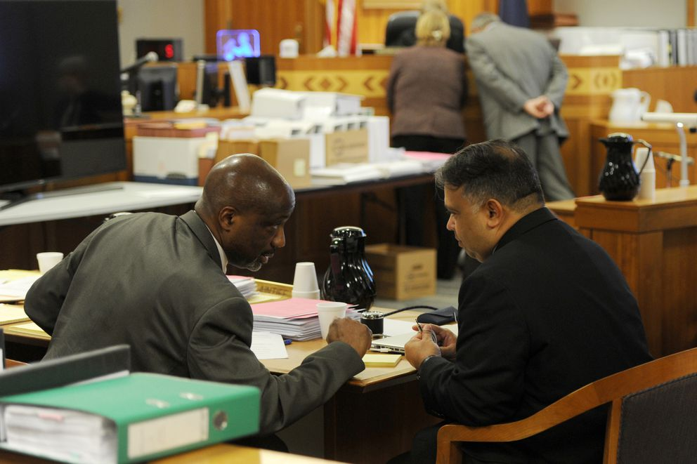 Plaintiffs Alvin Kennedy, left, and Eliezer Feliciano confer in a February hearing at Nesbett Courthouse. (Erik Hill / Alaska Dispatch News)