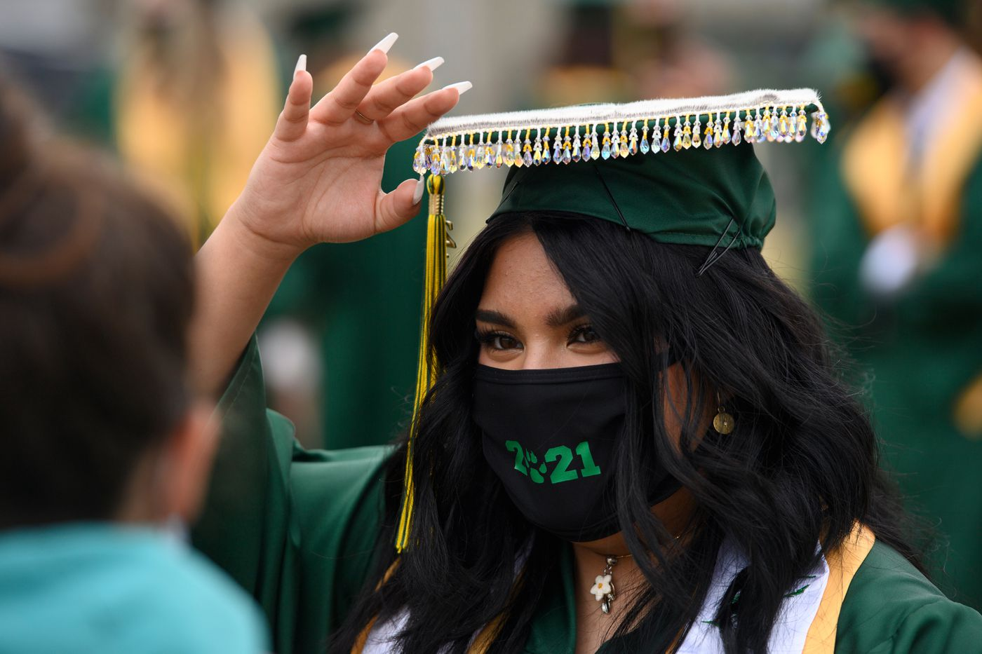 Aynzli Abad wore a mortarboard with beading along its edges to her Service School Graduation on May 12, 2021. She said she wanted her graduation attire to cap and stole to reflect her Inupiaq and Filipino pride. (Marc Lester / ADN)