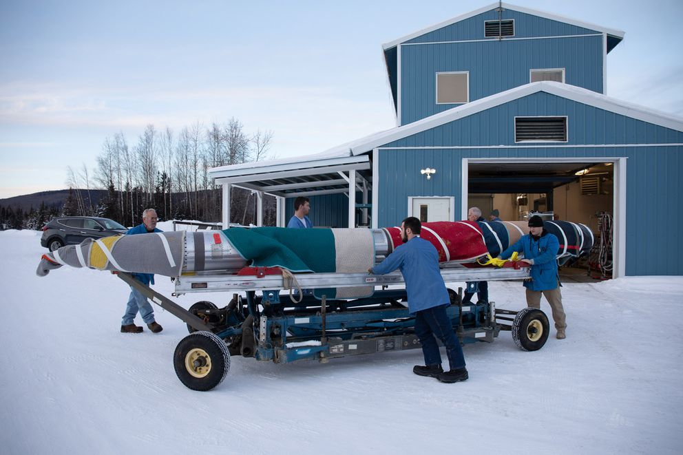 The payload portion of a NASA sounding rocket is wrapped and rolled outside in anticipation of a launch from Poker Flat Research Range north of Fairbanks on Jan. 22, 2019. (Photo by Chris Perry / NASA)