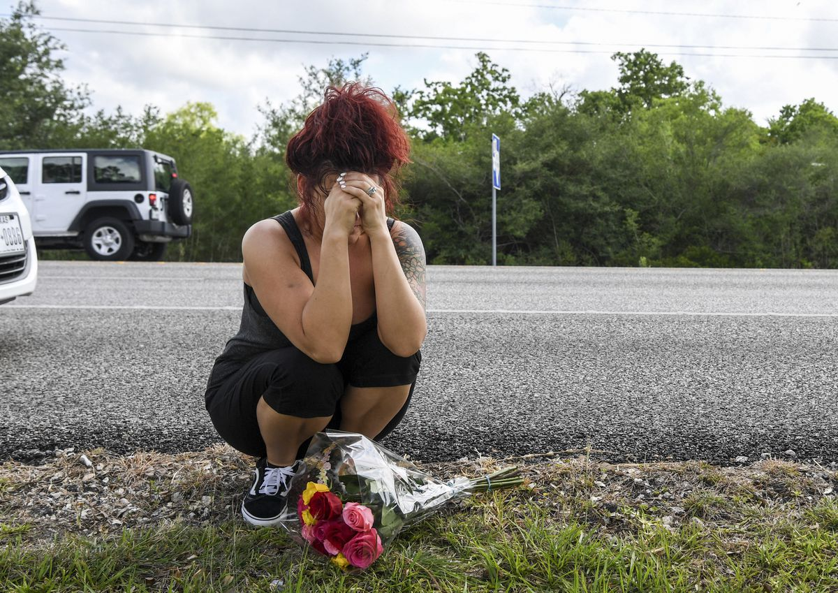 Wendy Long cries as she waits for her daughter's friend to retrieve personal belongings from Santa Fe High School in Texas. (Washington Post photo by Jonathan Newton)