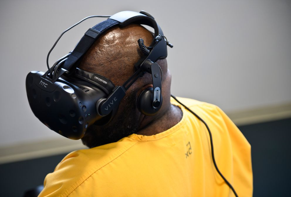 Lamont Moore tries a meditative scenario during a virtual reality demonstration. (Marc Lester / ADN)