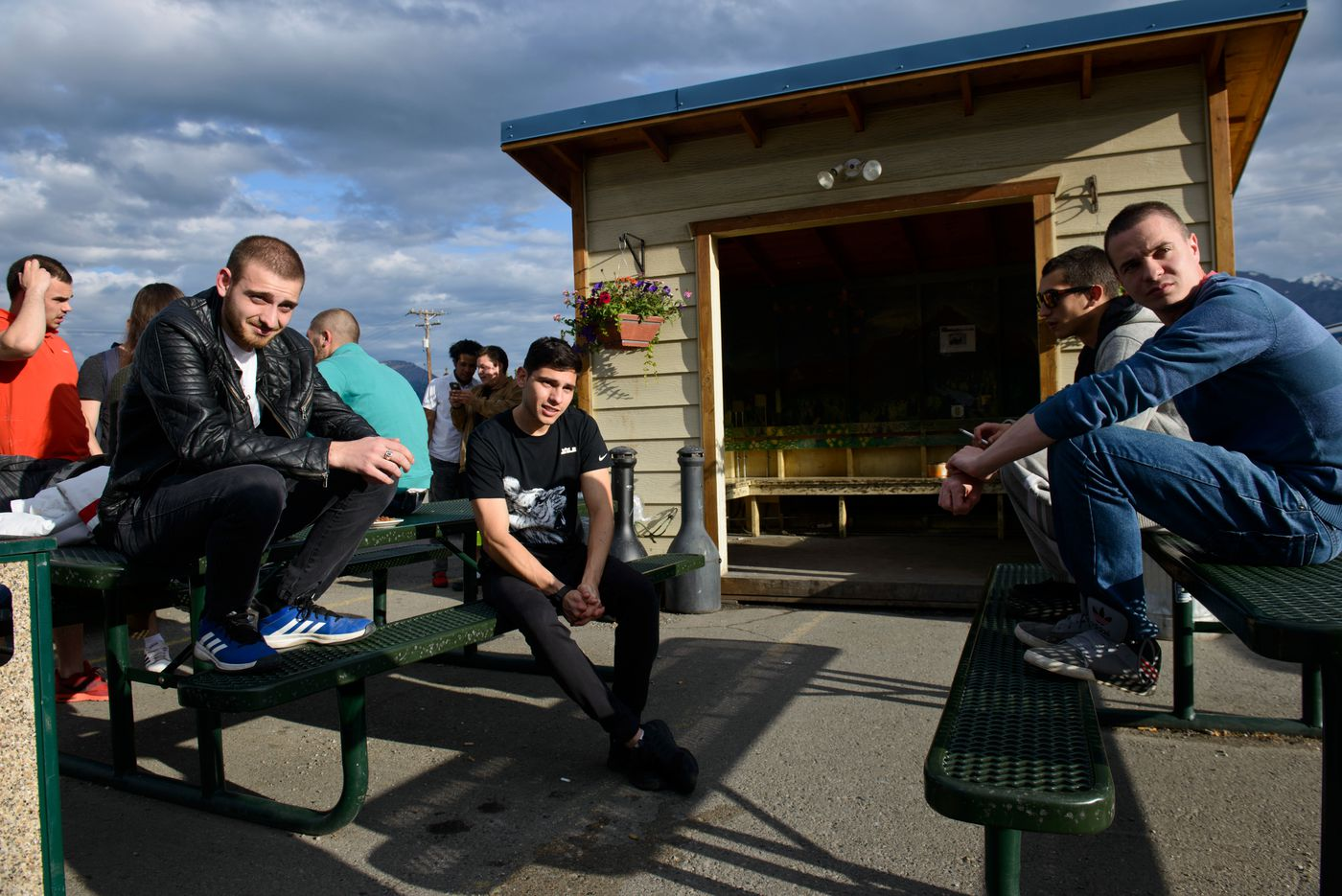 LubomirMarkov, Desislav Yordanov and Nedko Georgiev smoke and talk outside their housing in Healy. Yordanov works as a busser and the other two as housekeeping supervisors. They said working in a somewhat remote part of the state meant there were fewer places to spend money. (Marc Lester / Alaska Dispatch News)