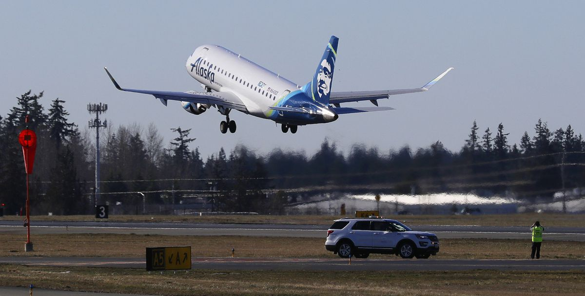 An Alaska Airlines Embraer 175 airplane bound for Portland, Ore., takes off Monday, March 4, 2019, at Paine Field in Everett, Wash. (AP Photo/Ted S. Warren)