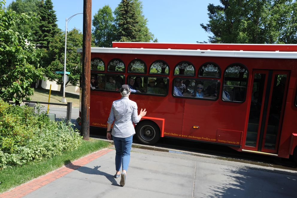 Marnie Isaacs walks out to talk with visitors on the trolley tour in mid-June. The trolley stops by their house twice an hour all summer long. (Anne Raup / ADN)