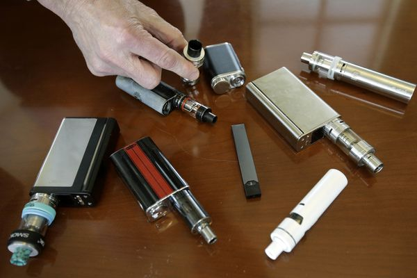 In this Tuesday, April 10, 2018 photo, Marshfield High School Principal Robert Keuther displays vaping devices that were confiscated from students in such places as restrooms or hallways at the school in Marshfield, Mass. Officials on Wednesday, August 21, 2019 said the Food and Drug Administration has joined the Centers for Disease Control and Prevention and a number of states in the investigation. of breathing illnesses among people who vape. Health officials are now looking into more than 150 possible cases in 16 states. (AP Photo/Steven Senne)