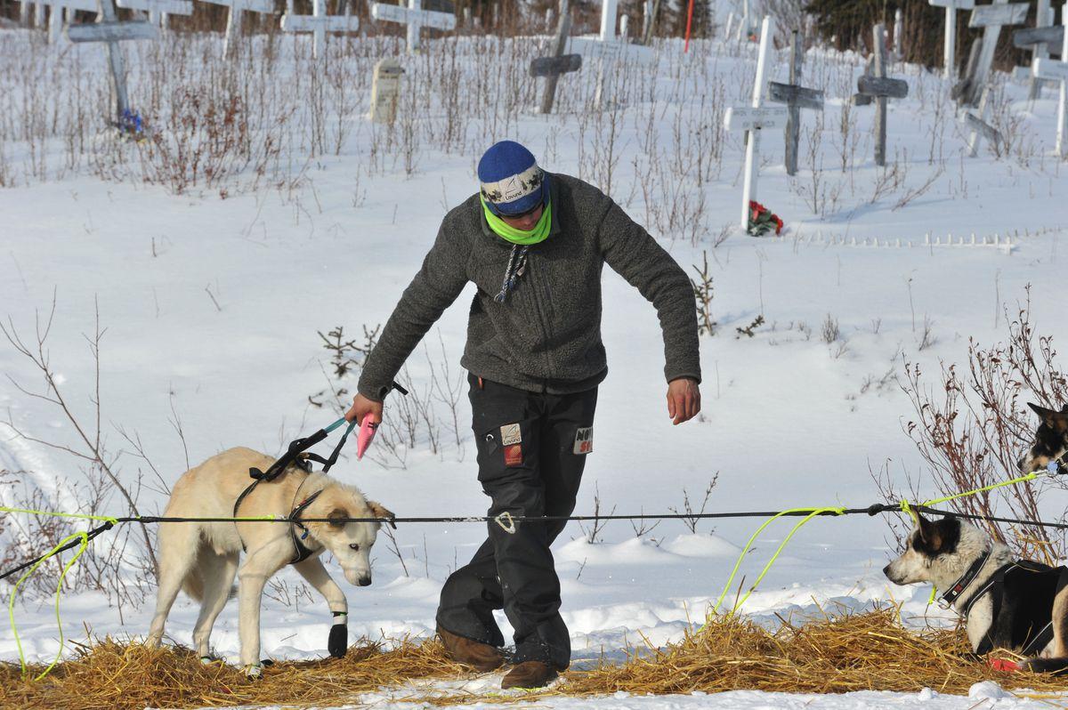 Fourth-place Joar Leifseth Ulsom works with his dog team in Koyuk on Monday. (Bob Hallinen / Alaska Dispatch News)