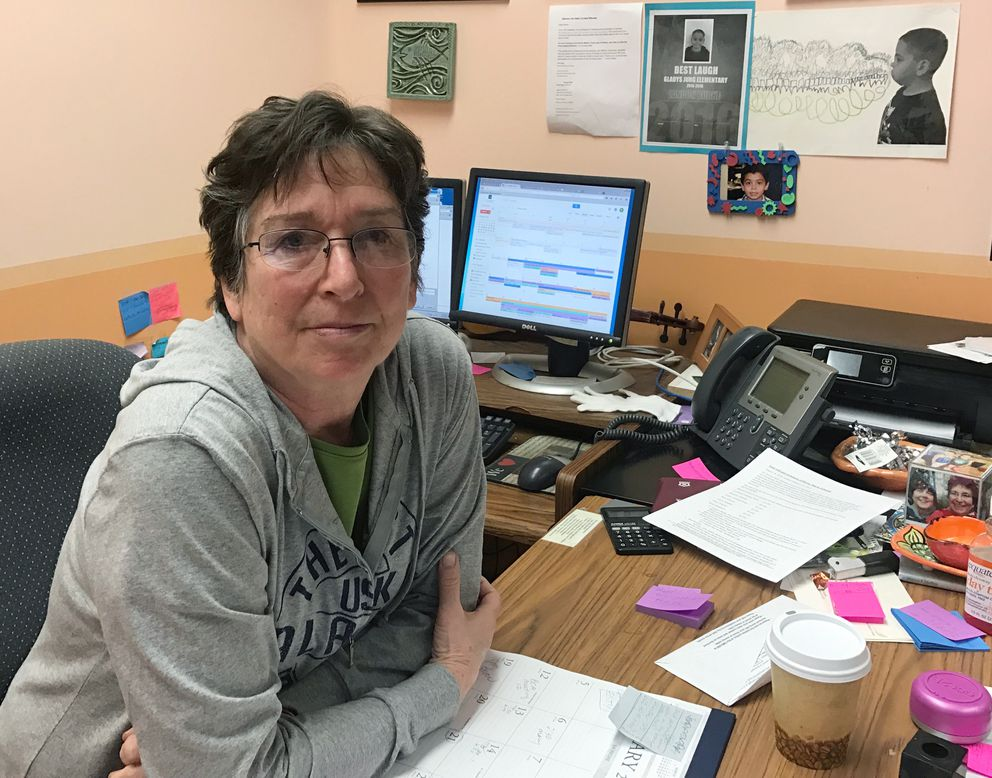 Reyne Athanas was the art teacher at Bethel Regional High School 20 years ago when Evan Ramsey shot and killed the principal and a fellow student. She tried to get him to give her the gun and surrender. She is seen recently in her office at the Yupiit Piciryarait Cultural Center in Bethel. (Lisa Demer / Alaska Dispatch News)