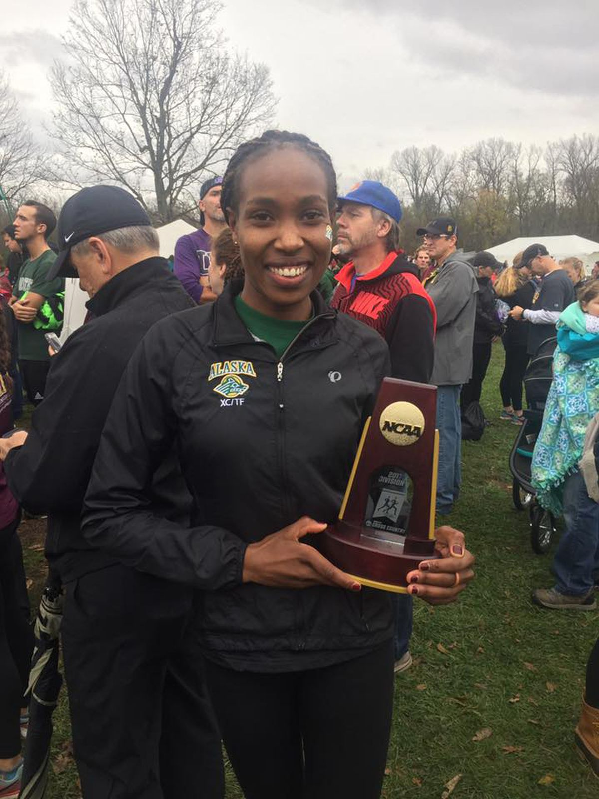 UAA's Caroline Kurgat holds her national championship trophy Saturday in Evansville, Indiana. (Photo courtesy of UAA).