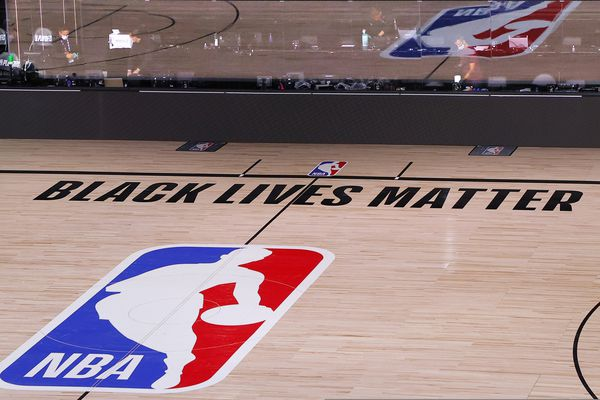 An empty court and bench are shown with no signage following the scheduled start time in Game 5 of an NBA basketball first-round playoff series, Wednesday, Aug. 26, 2020, in Lake Buena Vista, Fla. NBA players made their strongest statement yet against racial injustice Wednesday when the Milwaukee Bucks didn't take the floor for their playoff game against the Orlando Magic.(Kevin C. Cox/Pool Photo via AP)