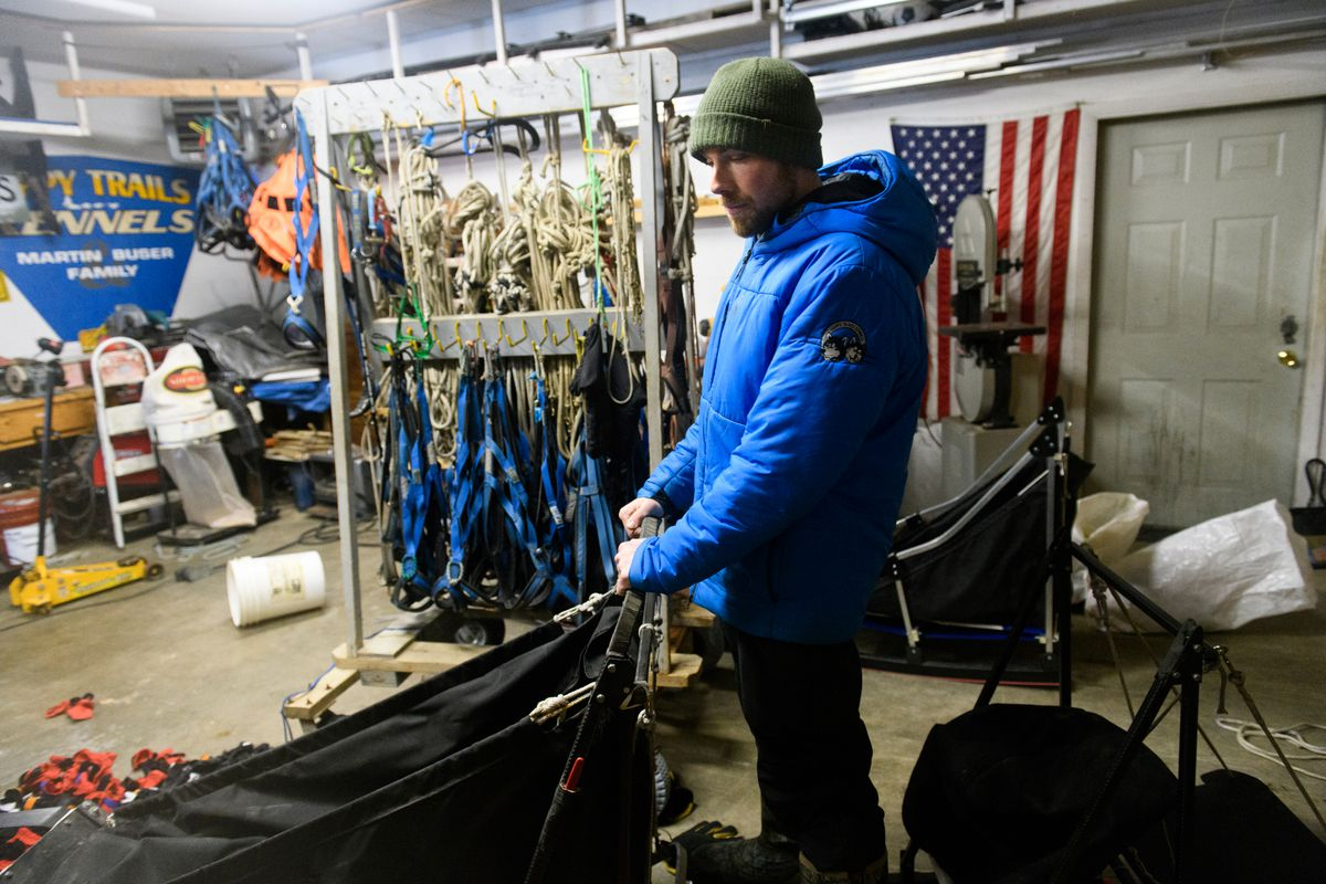 Tim Pappas looks over his sled in the days leading up to this year's Iditarod. (Marc Lester / ADN)