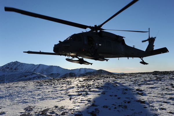 A HH-60G Pave Hawk helicopter from the 210th Rescue Squadron takes off during a training mission in the Chugach Mountains east of Anchorage on Wednesday, Jan. 21, 2015.