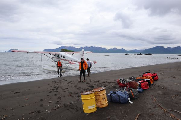 A team of scientists unloads food and gear from a floatplane on a beach in the Aniakchak National Monument & Preserve. (Photo for The Washington Post by Emily Schwing)