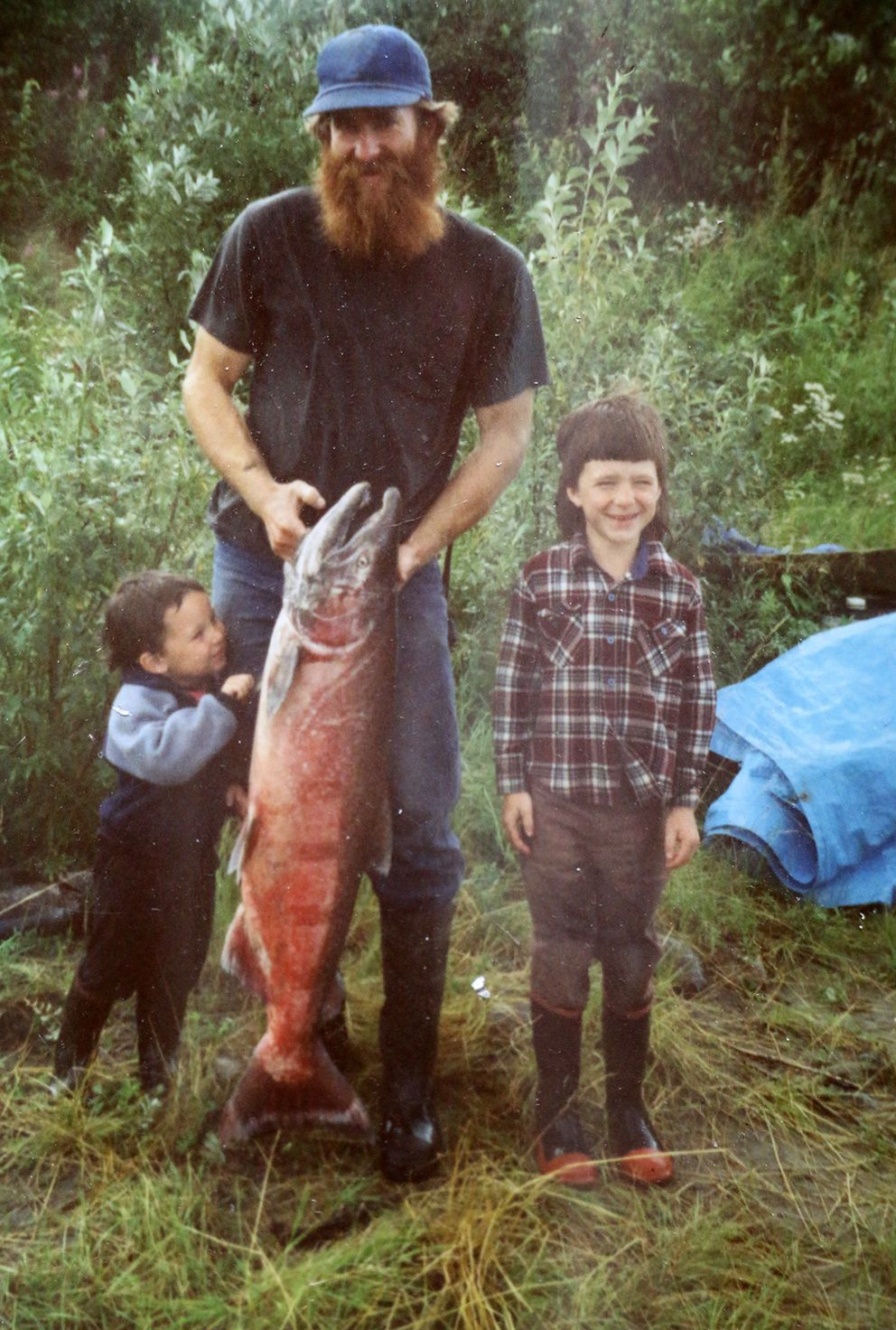 Randy Brown at his fish camp on the Yukon in 1989 or 1990 with his sons Gabe (to his right) and Jed (Courtesy of Randy Brown)