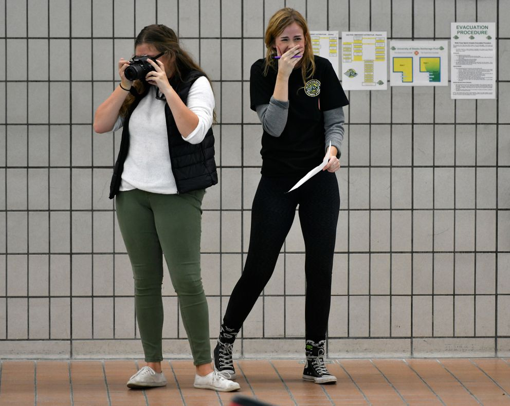 Kirsten Fischer, an intern in UAA's recreation department, right, laughs during competition. (Marc Lester / ADN)