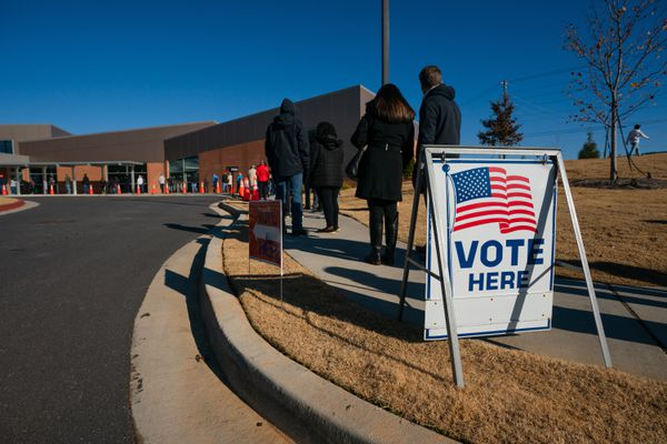 People wait to vote in the Georgia Senate runoff elections at North Cobb Regional Library in Kennesaw in December 2020. Photo for The Washington Post by Kevin D. Liles