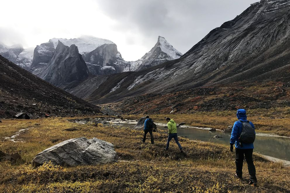 Climber Andi Schweers eyes Caliban, the peak at right, from atop a boulder in the Arrigetch Valley in Gates of the Arctic National Park on Friday, Aug. 31, 2018. (Vicky Ho / ADN)