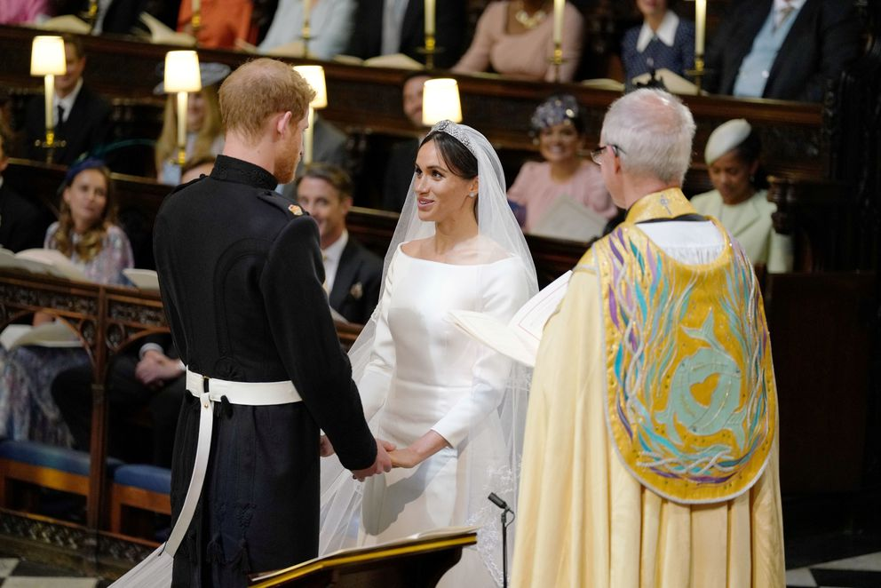 The Prince of Wales leads Meghan Markle up the aisle of St George's Chapel, Windsor Castle for her wedding to Prince Harry in Windsor, Britain, May 19, 2018. Dominic Lipinski/Pool via REUTERS