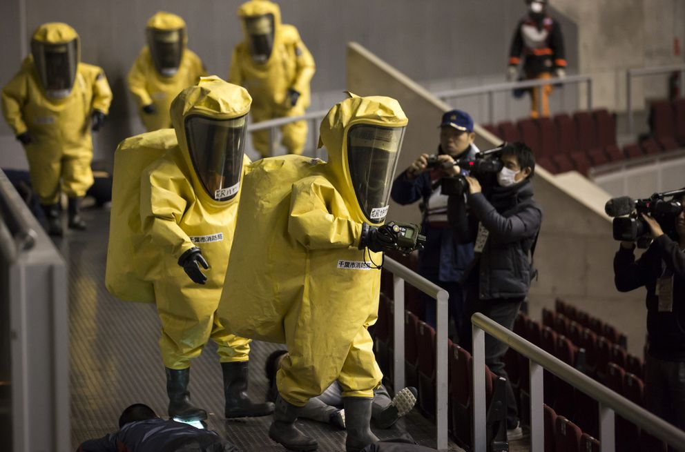 Members of the Chiba City Fire Department wearing protective suits participate in a sarin attack drill at the Makuhari Messe convention center in Chiba, Japan, on Wednesday, Jan. 24, 2018. (Bloomberg photo by Tomohiro Ohsumi)
