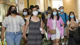 CDC urges masking in all schools and by vaccinated people in some indoor situations