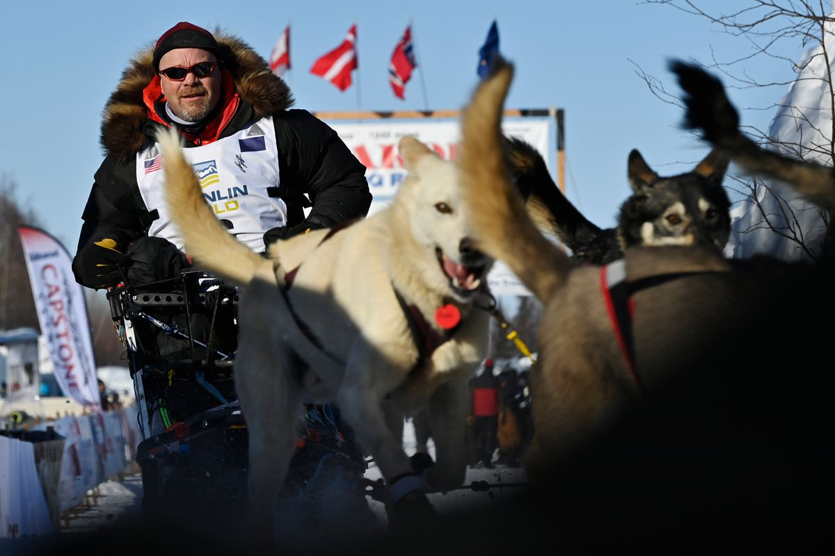 Aaron Burmeister and his team leave the starting area at Deshka Landing during the start of the 2021 Iditarod Trail Sled Dog Race on March 7. (Marc Lester / ADN)