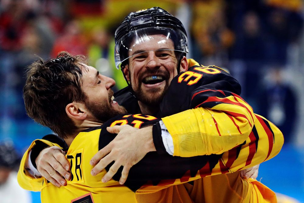 Ice Hockey - Pyeongchang 2018 Winter Olympics - Men Semifinal Match - Canada v Germany - Gangneung Hockey Centre, Gangneung, South Korea - February 23, 2018 - Matthias Plachta and Yannic Seidenberg of Germany celebrate their victory. REUTERS/David W Cerny TPX IMAGES OF THE DAY