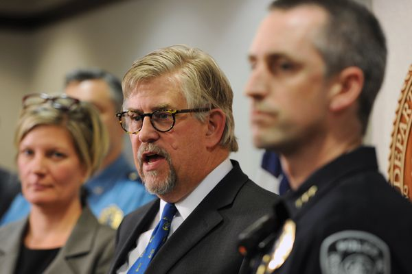 Acting U.S. Attorney Bryan Schroder, flanked by Alaska Attorney General Jahna Lindemuth, left, and Anchorage Police Chief Justin Doll, announced a multi-agency law enforcement initiative to reduce violent crime in Alaska during a news conference on Wednesday, Oct. 18, 2017. (Bill Roth / Alaska Dispatch News)