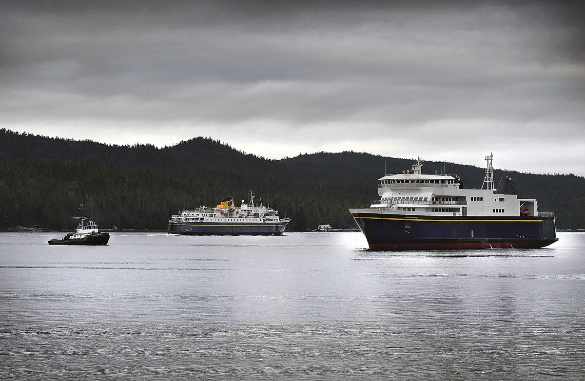In this Tuesday, Dec. 4, 2018 photo, the new Alaska Marine Highway System ferry Hubbard, right, undergoes sea trials in the view of the AMHS ferry Malaspina, center, in the Tongass Narrows near Ketchikan, Alaska. The tug Ethan B, seen at left, escorted the Hubbard from Ketchikan Shipyard into the north Channel, where crews completed a few rotational maneuvers using thrusters before starting the main engines and cruising northbound towards Guard Island. (Dustin Safranek/Ketchikan Daily News via AP)