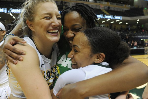 Shelby Cloninger, Dajhae Mullins and Sydni Stallworth, of UAA, celebrate after they defeated Tulsa in the Championship game of the 2017 Great Alaska Shootout 59-53 at the Alaska Airlines Center in Anchorage, Alaska on Thursday, Nov. 23, 2017. (Bob Hallinen / ADN)