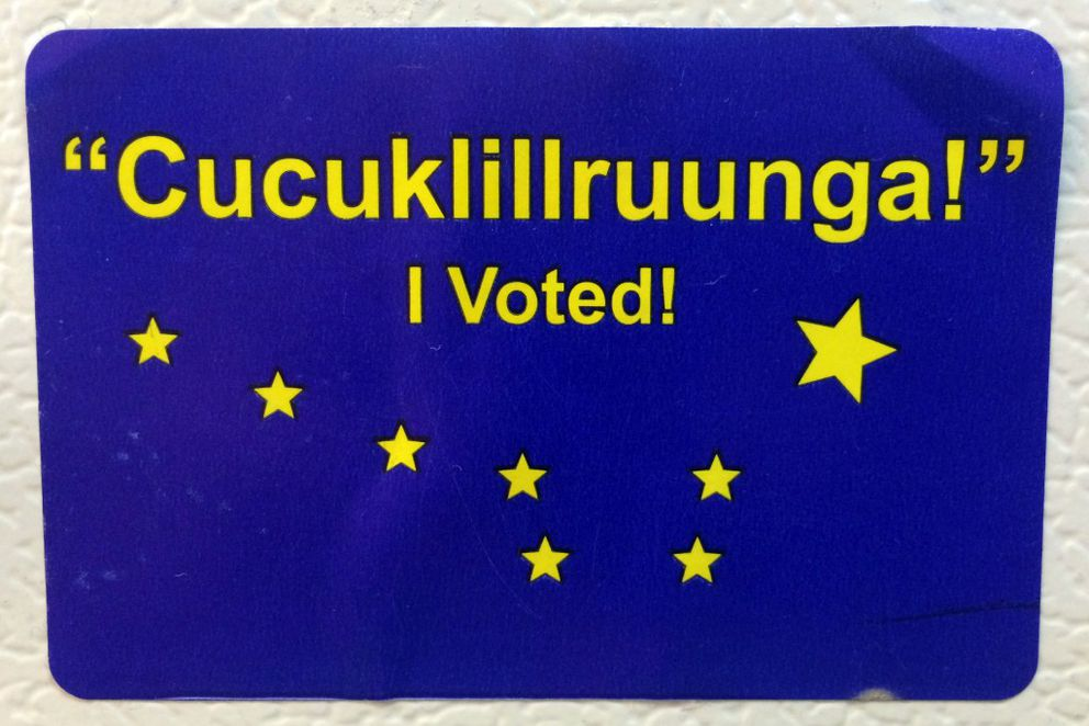 Bethel voters receive stickers in Yup'ik and English.(Lisa Demer / Alaska Dispatch News)