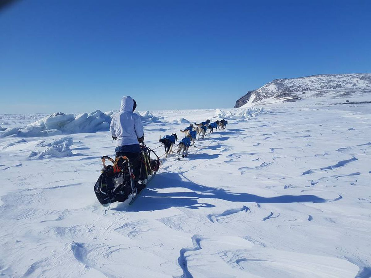 Vebjørn Aishana Reitan guides his team through the mountains outside Point Hope as he and his father hop from village to village throughout the North Slope on their way back home to Kaktovik. (Photo courtesy the Arctic Sounder)