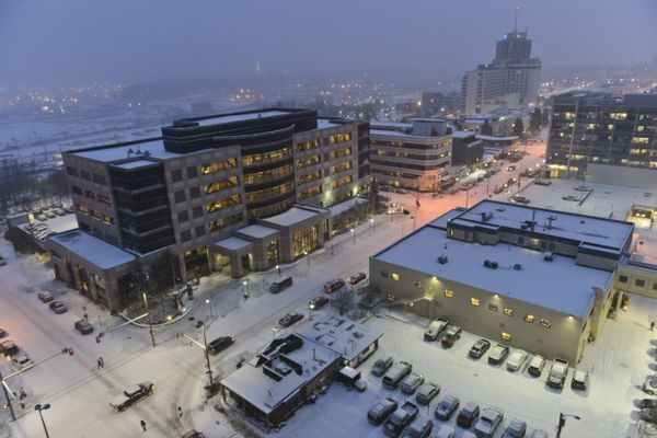 Snow blankets downtown Anchorage in this view over 4th Avenue near H Street on December 2, 2019. (Marc Lester / Anchorage Daily News)