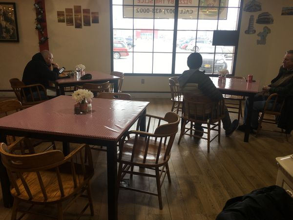 """Saverio's Pizzeria is an airy, bright space with red checked tablecloths, Italian murals and music of the """"O Sole Mio"""" variety. (Photo by Mara Severin)"""