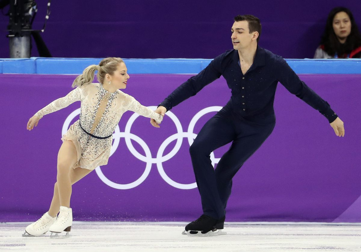 Alexa Scimeca Knierim and Chris Kneirim of the U.S. in the team pair skating short program on Thursday . REUTERS/Lucy Nicholson