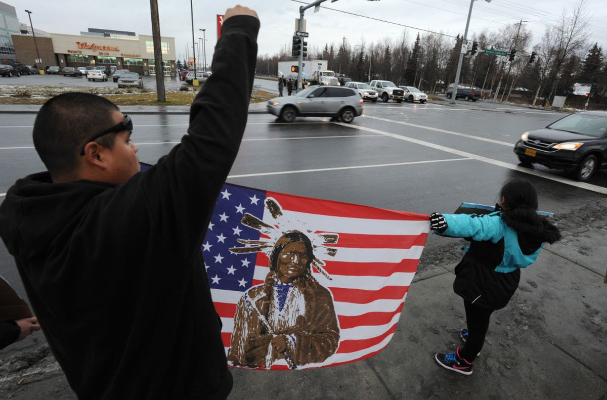 Myhi VanFleet and his daughter Shannowa VanFleet joined other Alaskans as they showed their support for the Standing Rock Sioux Tribe and their battle against the Dakota Access Pipeline on Sunday at the corner of Northern Lights Boulevard and Seward Highway in Anchorage. (Bill Roth / Alaska Dispatch News)