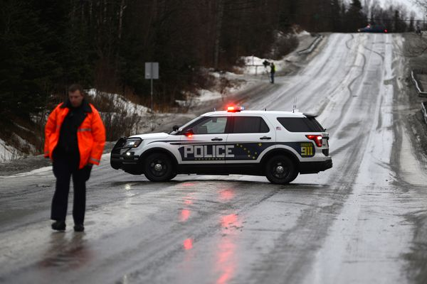 Rabbit Creek Road was closed Monday morning between Loc Loman Lane and Elmore Road due to extremely icy conditions. Warmer temperatures and rain moved through the area leaving snow-covered streets slick Feb. 12, 2018. (Anne Raup / ADN)