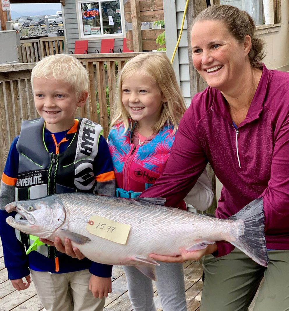 Michelle Murray of Eagle River holds the 15.99-pound silver salmon she caught near the head of Resurrection Bay. (Photo provided by Seward Chamber of Commerce)