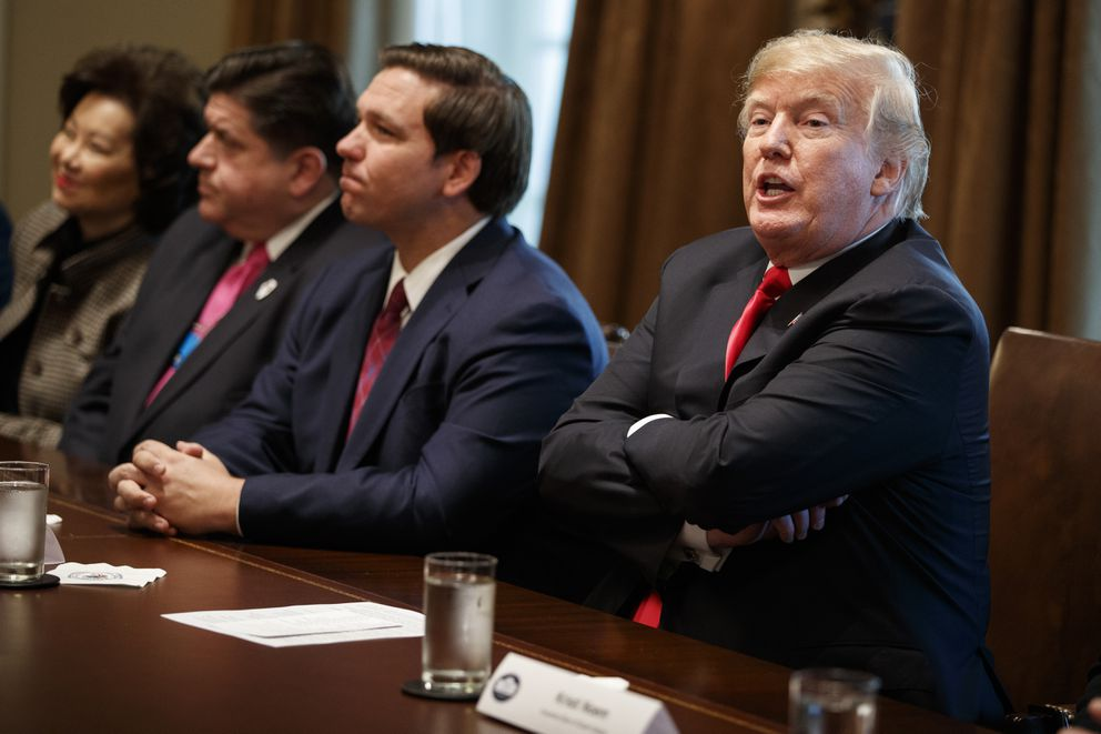 President Donald Trump speaks during a meeting with newly elected governors in the Cabinet Room of the White House, Thursday, Dec. 13, 2018, in Washington. From left, Secretary of Transportation Elaine Chao, Gov.-elect J.B. Pritzker, D-Ill., Gov.-elect Ron DeSantis, R-Fla., and Trump. (AP Photo/Evan Vucci)