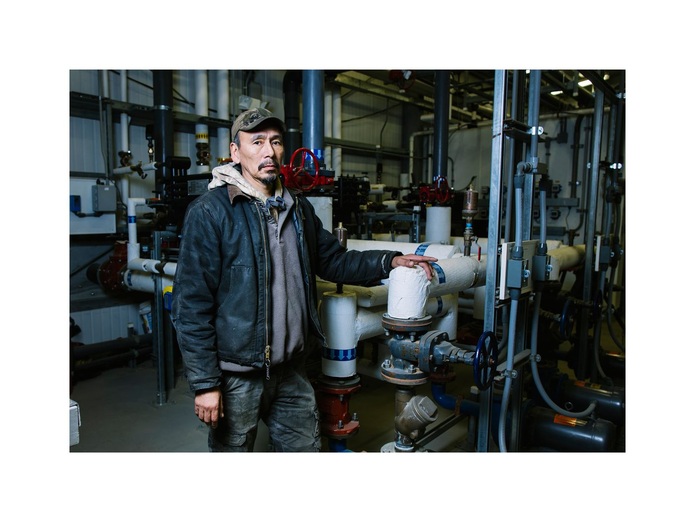 Varlam Jackson, one of the water treatment plant operators posing in the new plant. (Photo by Kerry Tasker)