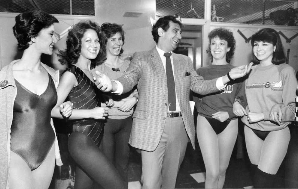 FILE - In this Feb. 27, 1984, file photo, singer Placido Domingo laughs with members of the Rockettes at New York's Radio City Music Hall. The singer and dancers met while rehearsing for Channel Thirteen's 'Gala of Stars 1984. ' Nine women in the opera world have told The Associated Press that they were sexually harassed by Domingo, one of the most celebrated and powerful men in opera. The women say the encounters took place over three decades, at venues that included opera companies where he held top managerial positions. (AP Photo/Steve Friedman, File)