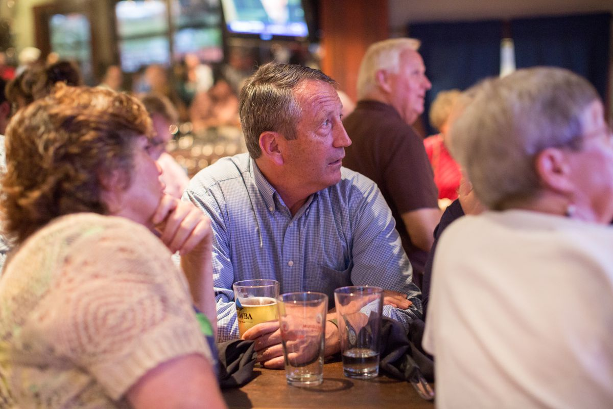 "Rep. Mark Sanford (R-S.C.) watches returns at his primary night party in Mt. Pleasant, S.C., June 12, 2018. Sanford had voted for much of President Donald Trump's agenda, but repeatedly lamented what he called the ""cult of personality"" gripping the party. His opponent, state Representative Katie Arrington, used those critiques against him to great effect. (Hunter McRae/The New York Times)"